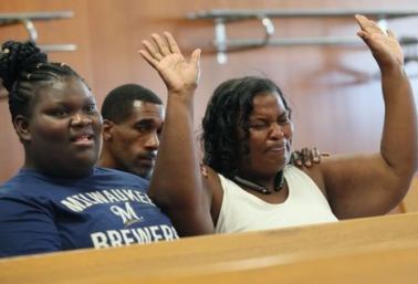 Beverly Walker (right) and her daughter Wisdom Walker (left) react as the judge makes his decision.